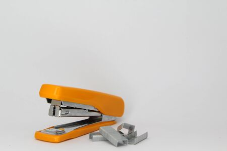 staple: Closeup of orange stapler and staple.