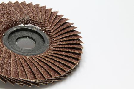 abrasive: Closeup of red color flap abrasive disc.