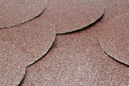 sandpaper: Disk of brown sandpaper texture background. Stock Photo