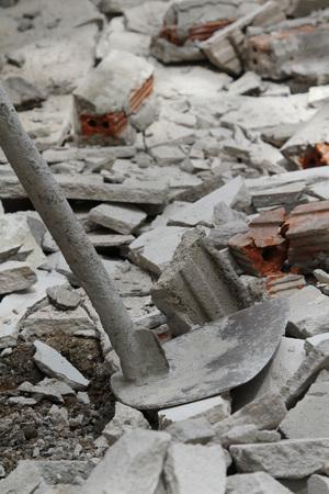 lain: Old hoe lain on the gray concrete.