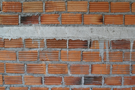 solidity: Brick wall texture background on construction site.
