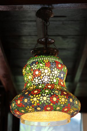 Colorful lantern lamp with blured background. Stock Photo