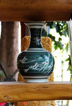 antique vase: Chinese antique vase on wooden stick.