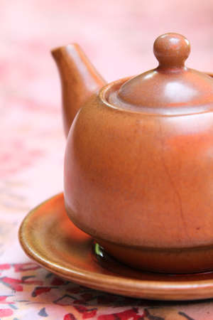 chinese teapot: Brown chinese teapot on the table.