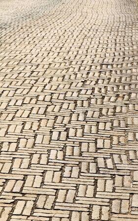split road: Red brick road, pavement texture.