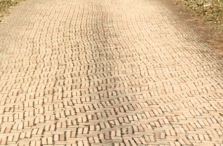 brick road: Red brick road, pavement texture.