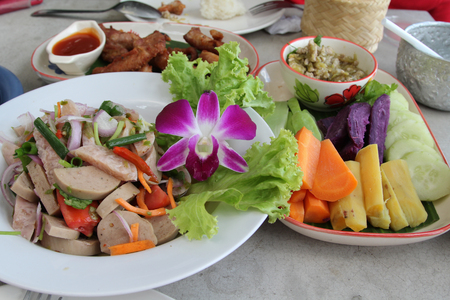 Northern Thai cuisine, spicy green chili pork with boiled vegetables and spicy pork salad.