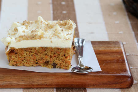 Slice of home made carrot cake with buttercream. Stock Photo