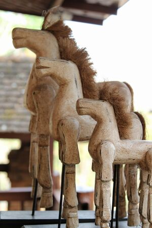 Wooden toy horse in living room.
