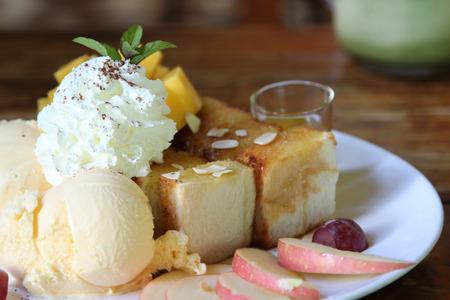 Honey toast and ice-cream serve with fruit.