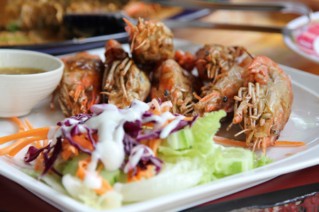 Thai food, fried prawns with salt and chili serve with fresh vegetable salad dressed with mayonnaise. Stock Photo