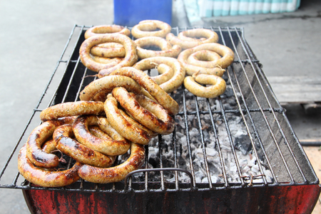 Thai food, grilled Thai sausages Northern style on stove at market. Stock Photo