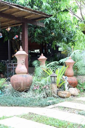 Thai Earthenware, ancient jar decorated in garden.