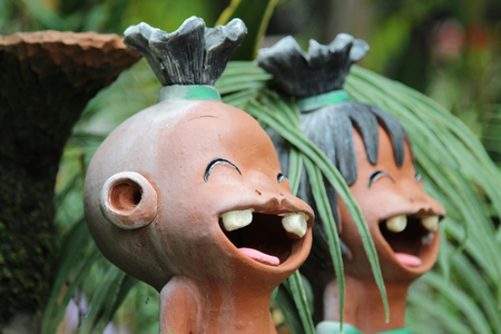 The smile dolls made of clay decorated in garden. Stock Photo