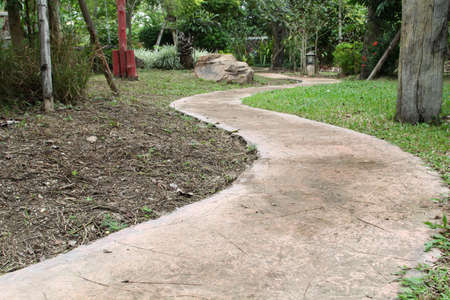Curve pathway in public park. Stock Photo