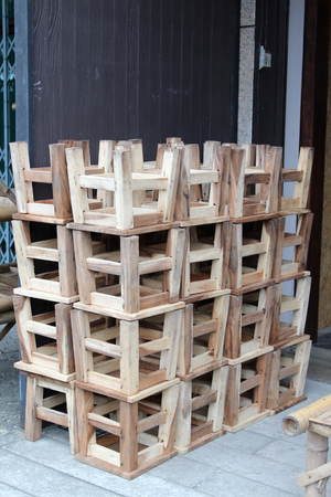 Pile of wooden chair at roadside. Stock Photo