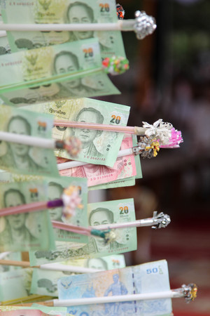 Thai 20 bank notes in make merit from Thai buddhism. Stock Photo