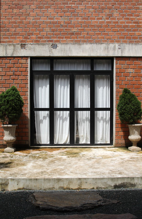 Black Aluminum Door With Glass Frame On Brick Wall Stock Photo