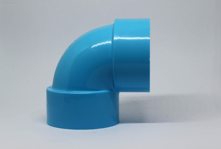 PVC pipe fitting on white background.