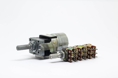 Motor drive and six gangs potentiometers or variable resistors on white background. Sajtókép