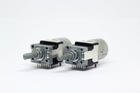 Two motor drive potentiometers or variable resistors on white background.