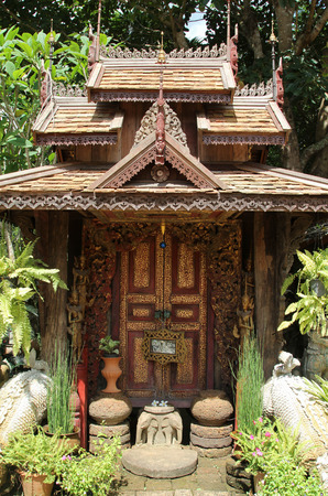 Northern Thai style wooden carved door.