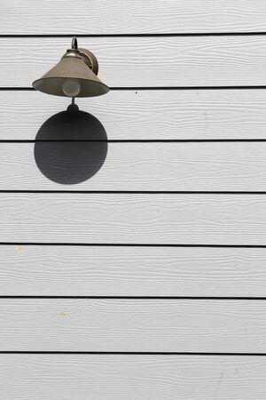 Old streetlamp on the  artificial gray wood board. Stock Photo