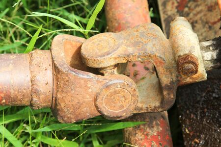 Old drive shaft, propeller shaft and universal joint of tractor. 写真素材