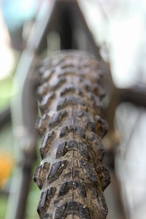 Close up of old motocross bicycle tyre texture.