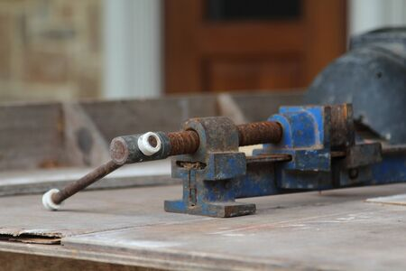 Old clamp use for clamped pieces of wood in carpentry workshop.