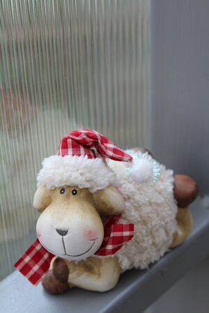 The smile teddy sheep and translucent corrugated plastic wall background.