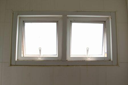 Ventilation windows on concrete wall in the bathroom.