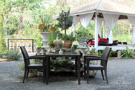 Luxury glass table and rattan chair for lunch outdoors.