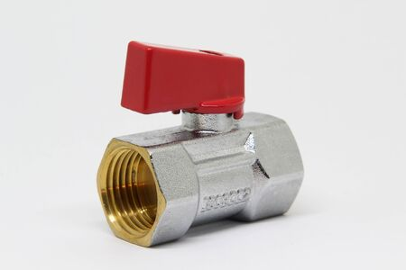 Brass ball valve with red handle on white background.