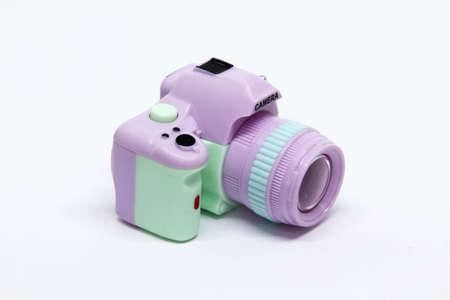 Mini camera toy isolated on white background.