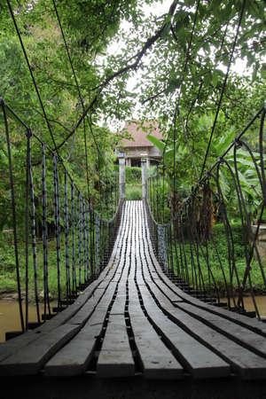 Suspension bridge across streams on rainy days.