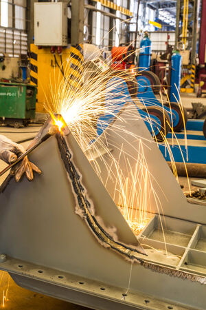 Cutting steel with in factory industry sparks photo