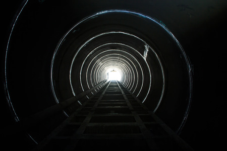 confined space: Lighting at the end of the tunnel  Stock Photo