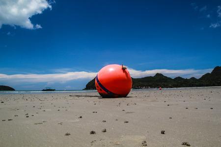 beach buoy: Beach buoy sea and blue sky Stock Photo