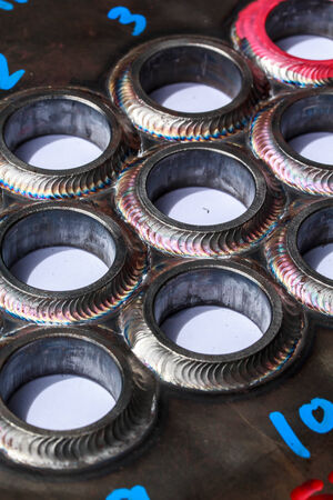 Welding pipe small circles used in industrial applications. photo