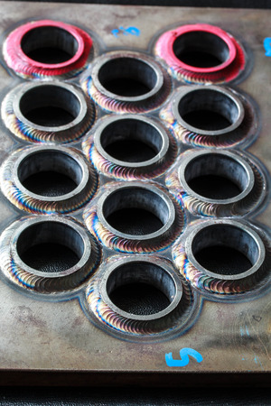 welded: Welding pipe small circles used in industrial applications. Stock Photo