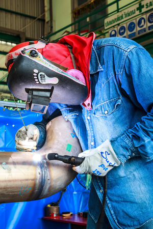 laboring: Welding sparks of welders in the industry.