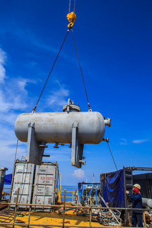 offshore: Crane lifting storage tank applications support offshore Industry oil work gas production petroleum pipeline.