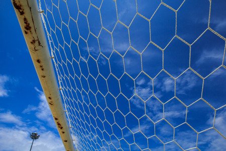 Soccer nets shooting in goal touch net agent the sky. Stock Photo