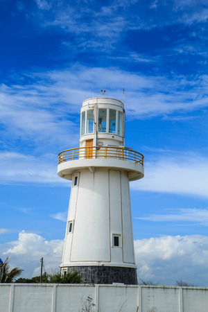 flue: White lighthouse and on a blue sky day