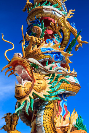 generality: Chinese style dragon statue and blue sky in Chinese temple,Thailand ( Generality in Thailand ,and kind of art decorated in Buddhist church, temple pavilion ,temple hall . They are public)