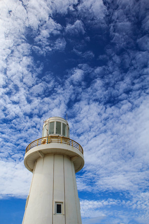 White lighthouse and on a blue sky day
