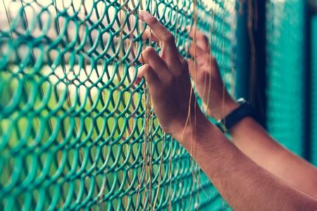 prisoner hand in jail. freedom concept
