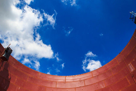 Storage tank oil about  wall  of tank production petroleum refinery  sky blue Stock Photo