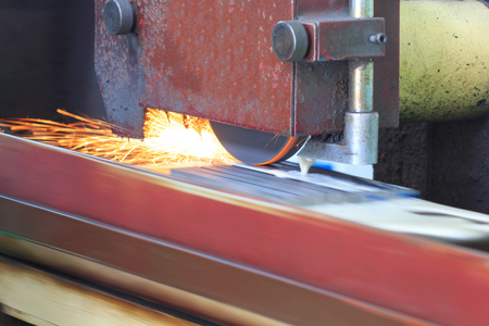 metalworking industry: finishing metal working on horizontal surface grinder machine with flying sparks Imagens